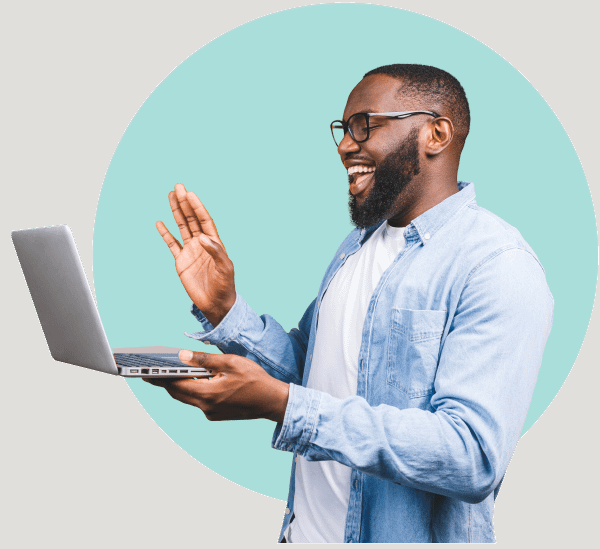 Man Smiling while holding computer blue circle background